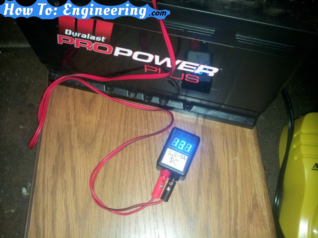 Checking car battery voltage with mini meter