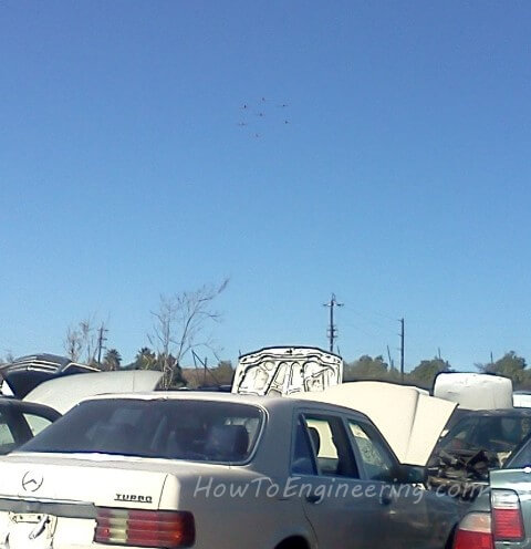 7 planes in formation above a scrap yard