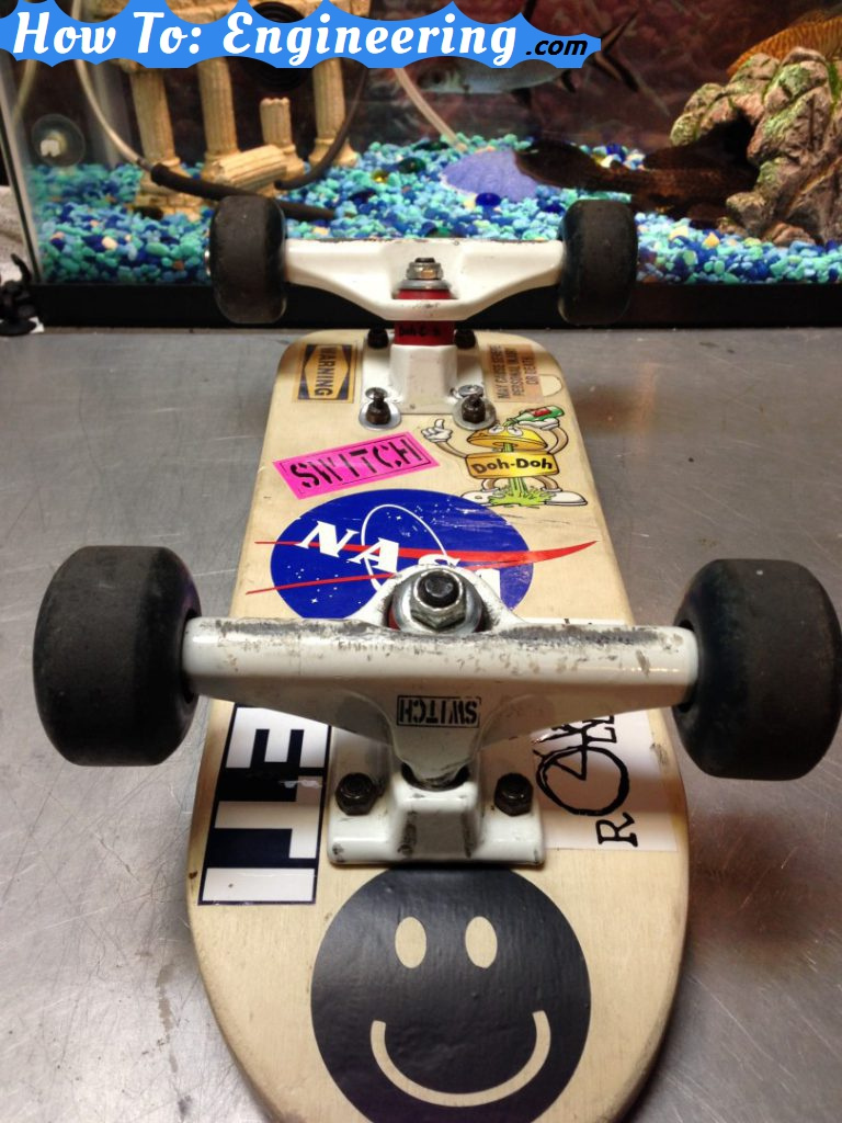 mini skateboard with fish background
