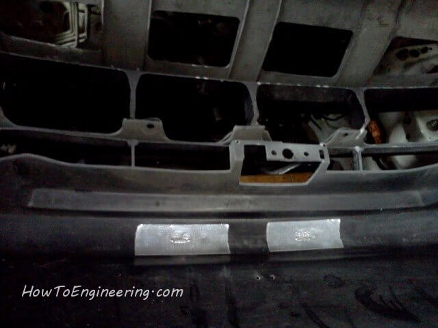 tape inside bumper holes for bondo